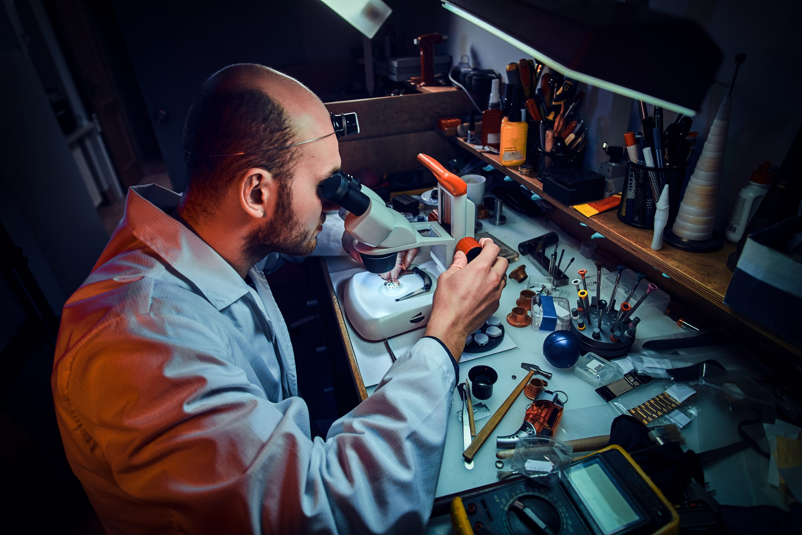 watchmaker repairing watch
